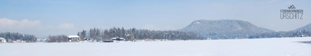 Der Tabor von Faak am See aus. Im Vordergrund die Insel und das Inselhotel. Drobollach am Faaker See befindet sich ungefähr hinter dem Inselhotel versteckt.
